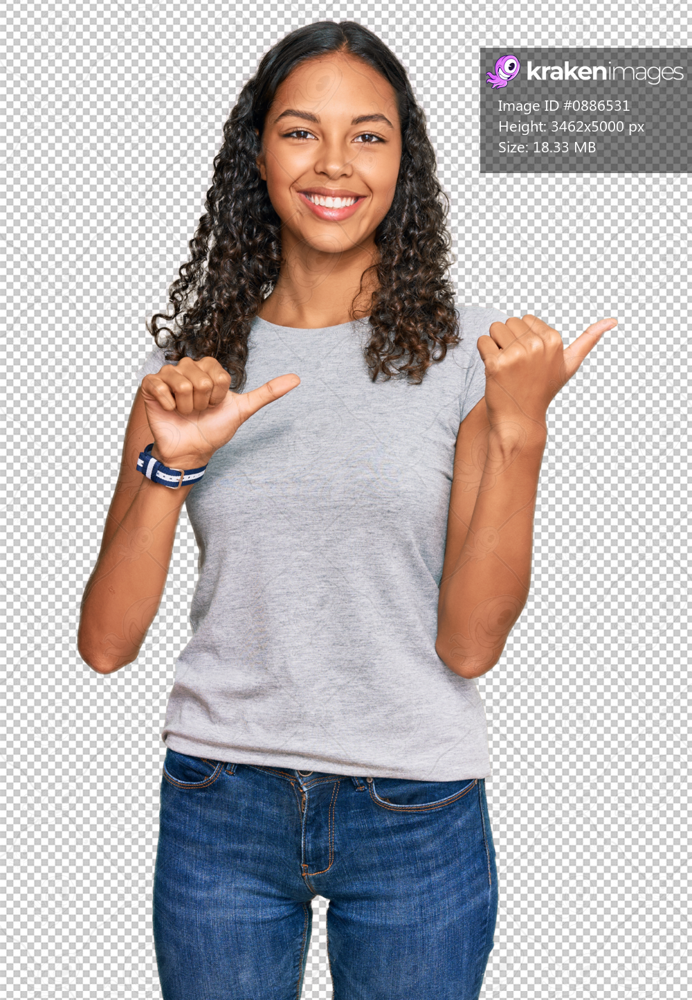 Young african american girl wearing casual clothes pointing to the back behind with hand and thumbs up, smiling confident