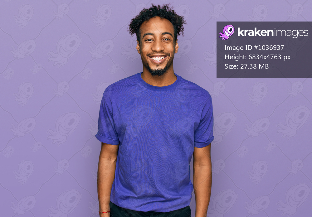 Young african american man with beard wearing casual purple t shirt with a happy and cool smile on face. lucky person.