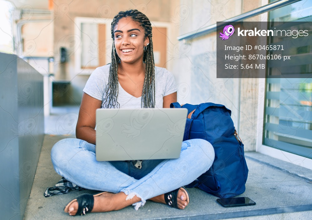 Young african american student woman smiling happy using computer laptop at the university campus
