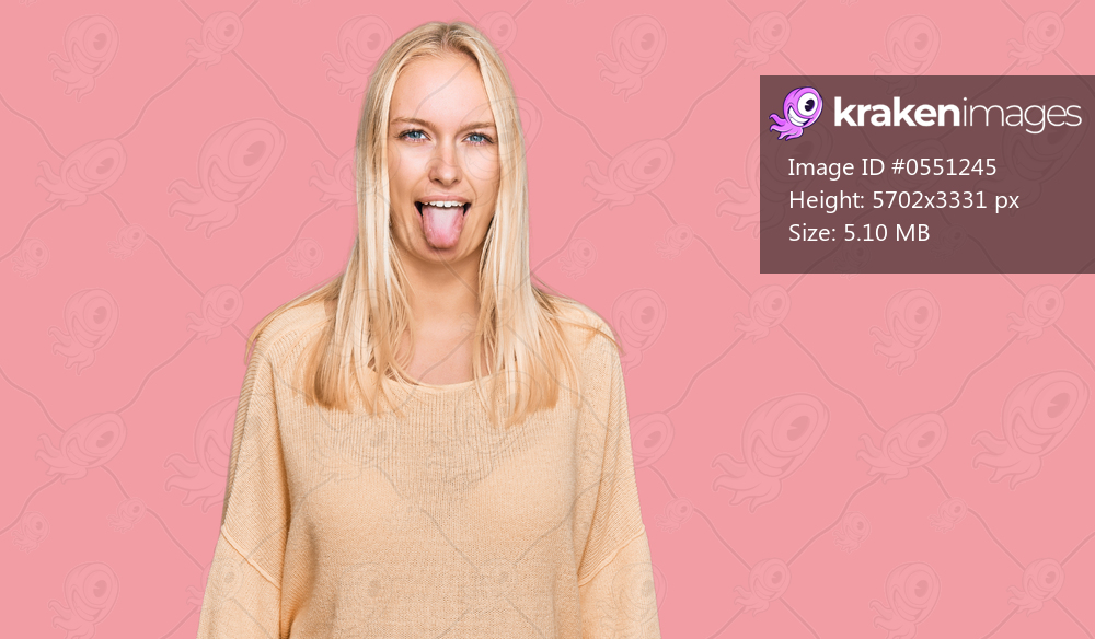 Young blonde girl wearing casual clothes sticking tongue out happy with funny expression. emotion concept.
