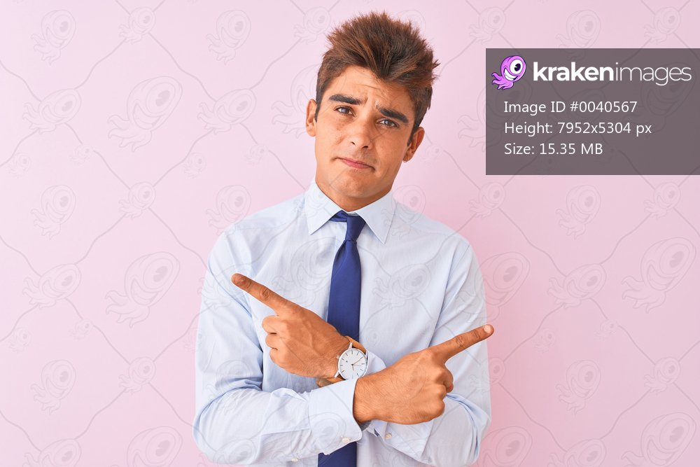 Young handsome businessman wearing shirt and tie standing over isolated pink background Pointing to both sides with fingers, different direction disagree