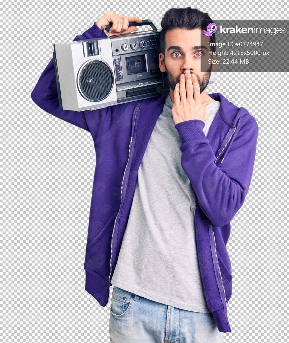 Young handsome man with beard listening to music using vintage boombox covering mouth with hand, shocked and afraid for mistake. surprised expression