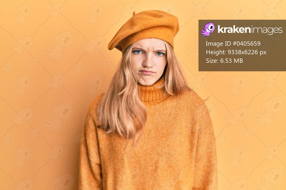 Beautiful young caucasian girl wearing french look with beret skeptic and nervous, frowning upset because of problem. negative person.