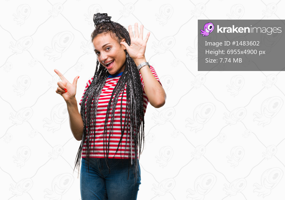 Young braided hair african american girl over isolated background showing and pointing up with fingers number seven while smiling confident and happy.