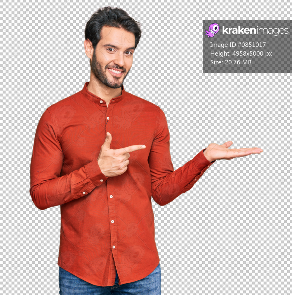 Young hispanic man wearing casual clothes amazed and smiling to the camera while presenting with hand and pointing with finger.