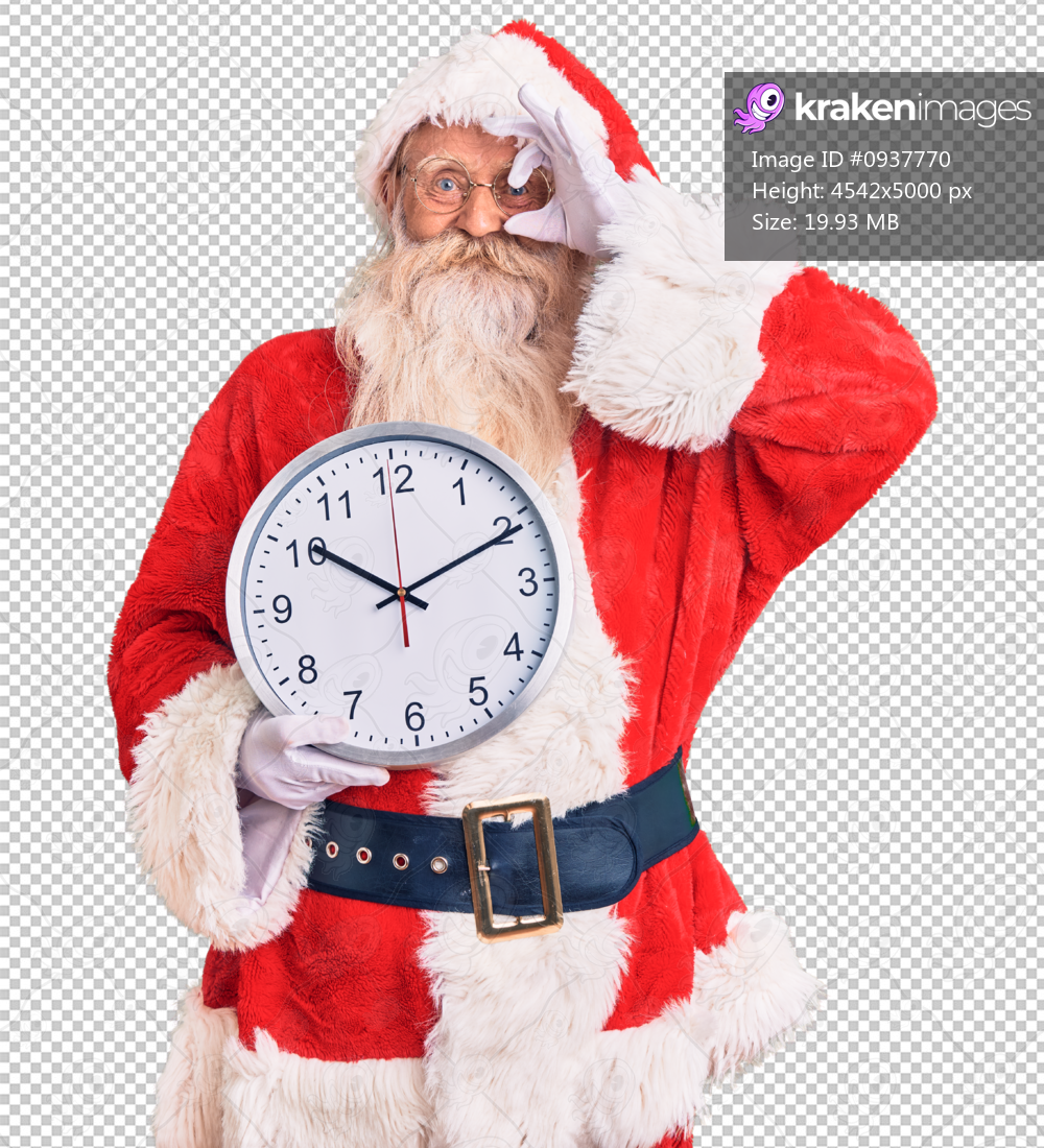 Old senior man with grey hair and long beard wearing santa claus costume holding clock smiling happy doing ok sign with hand on eye looking through fingers