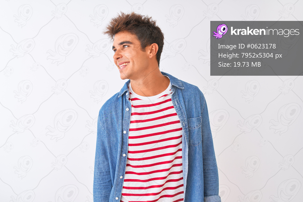 Young handsome man wearing striped t-shirt and denim shirt over isolated white background looking away to side with smile on face, natural expression. Laughing confident.