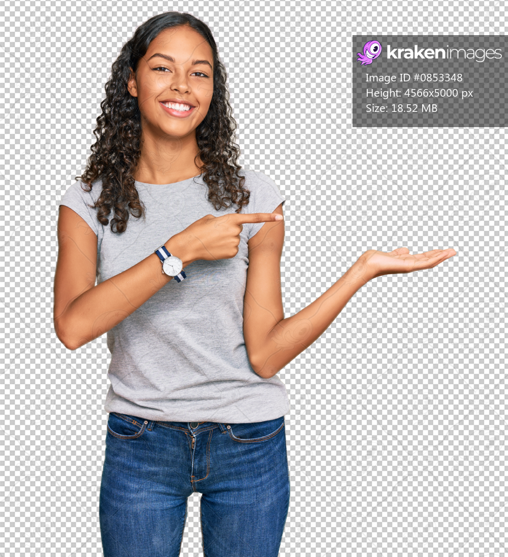 Young african american girl wearing casual clothes amazed and smiling to the camera while presenting with hand and pointing with finger.