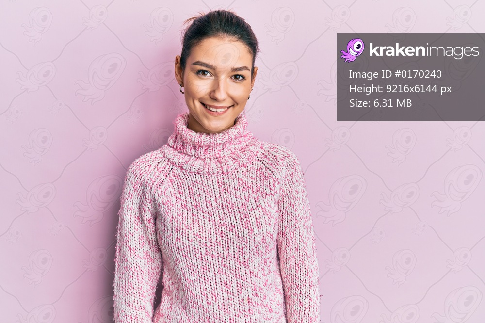 Young caucasian woman wearing wool winter sweater with a happy and cool smile on face. lucky person.