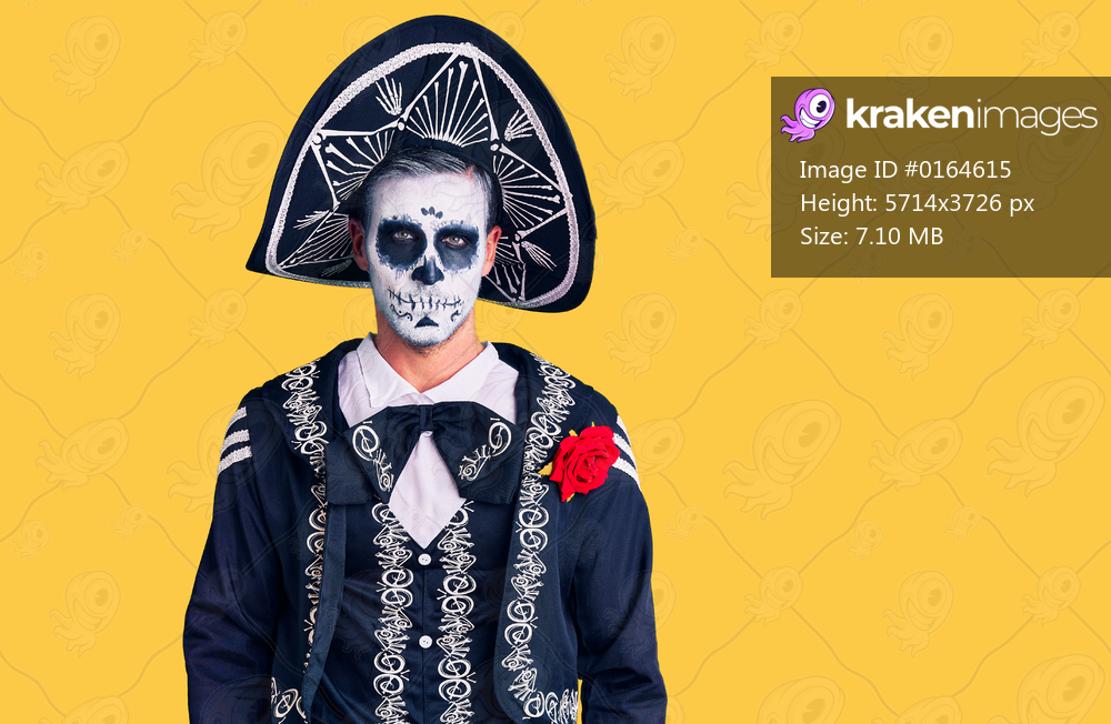 Young man wearing day of the dead costume over background depressed and worry for distress, crying angry and afraid. sad expression.