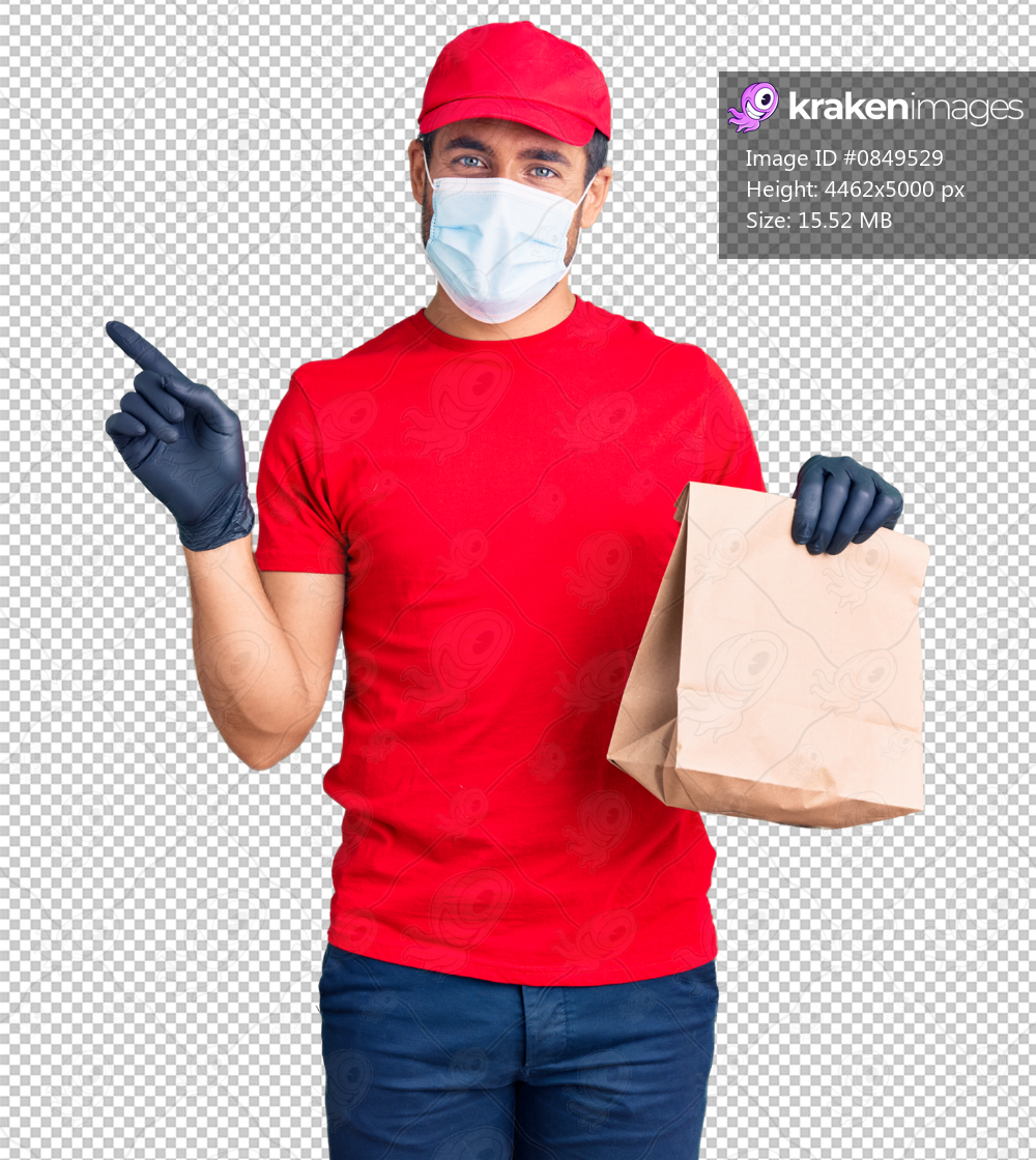 Young hispanic man delivering food wearing covid-19 safety mask holding paper bag smiling happy pointing with hand and finger to the side